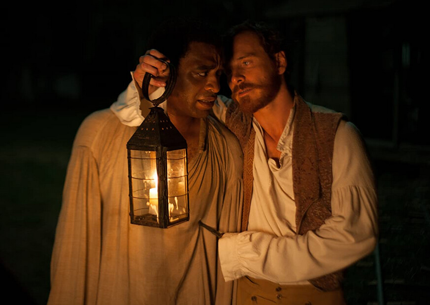 "man holding lantern threatens slave with a knife in ""12 Years a Slave"""