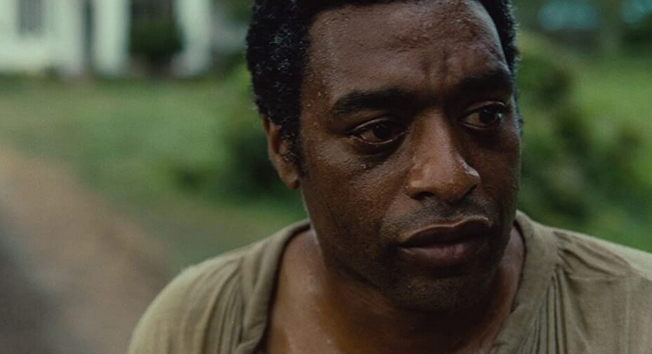 "Black man in with slave plantation in backgroup in ""12 Years a Slave"""