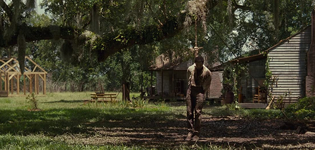 "man hanging from tree branch in ""12 Years a Slave"""