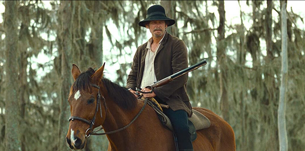 "man on horse with gun in ""12 Years a Slave"""