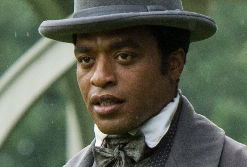 "man in grey hat in ""12 Years a Slave"""
