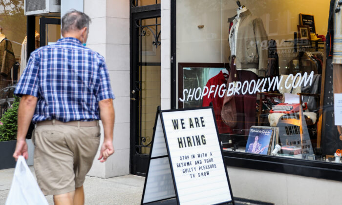 A hiring sign is displayed in front of a store in Brooklyn, New York on Oct. 7, 2020. (Chung I Ho/The Epoch Times)