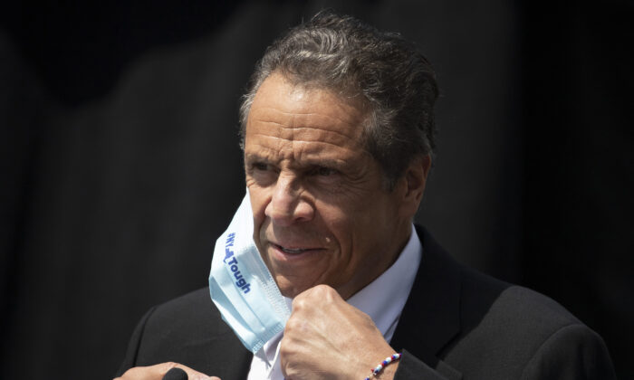 New York Gov. Andrew Cuomo removes a mask as he holds a news conference in Tarrytown, N.Y., on June 15, 2020. (Mark Lennihan, File/AP Photo)