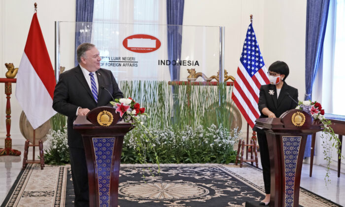 In this photo released by Indonesian Ministry of Foreign Affairs, U.S. Secretary of State Mike Pompeo, left, talks to Indonesian Foreign Minister Retno Marsudi during a joint press conference which was broadcasted online in Jakarta, Indonesia, Thursday, Oct. 29, 2020. (Indonesian Ministry of Foreign Affairs via AP)