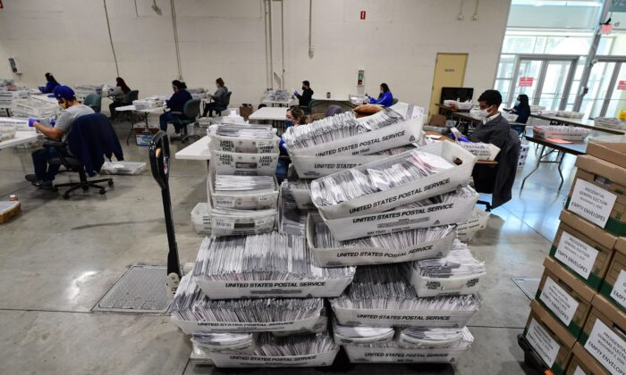 Bins of mail-in ballots await distribution to workers sorting the envelopes for the presidential election at the Los Angeles County Registrar Recorders' mail-in ballot processing center at the Pomona Fairplex in Pomona, Calif., on Oct. 28, 2020. (Robyn Beck/AFP via Getty Images)