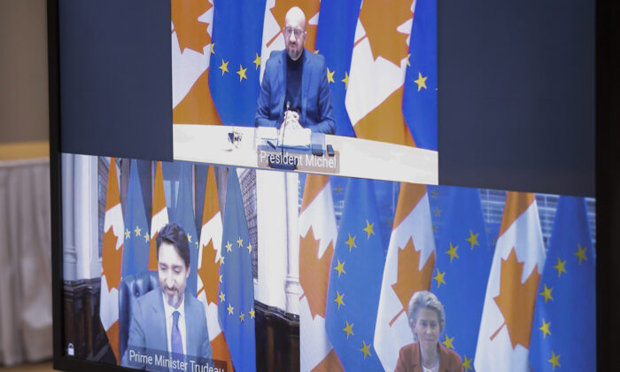 European Council President Charles Michel (top) speaks to Canadian Prime Minister Justin Trudeau and European Commission President Ursula von der Leyen, bottom via video link during an EU-Canada summit at the European Council building in Brussels on Oct. 29, 2020. (Olivier Hoslet, Pool/The Associated Press)