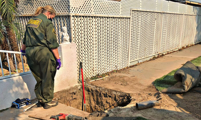 An Orange County coroner investigates the site where Native American bones were discovered in Santa Ana, Calif., on Oct. 27, 2020. (Courtesy of the Santa Ana Police Department)