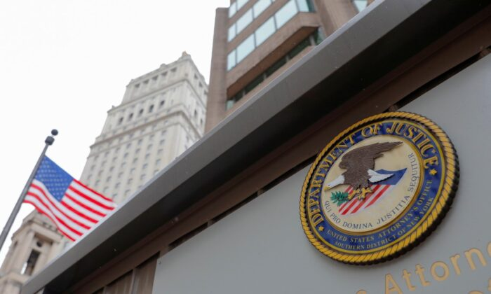 The seal of the United States Department of Justice is seen on the building exterior of the United States Attorney's Office of the Southern District of New York in Manhattan on Aug. 17, 2020. (Andrew Kelly/Reuters)