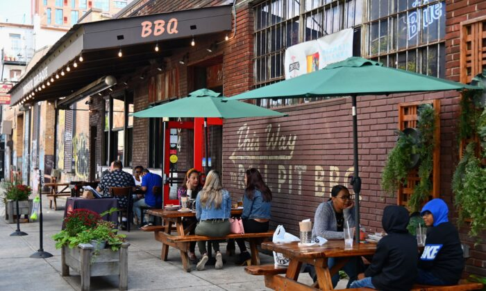 People dine outside at a restaurant in the Brooklyn borough of New York City, on Oct. 2, 2020. (Angela Weiss/AFP via Getty Images)