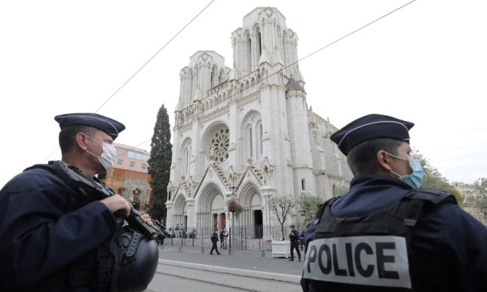 Police officers stand guard at the scene of a knife attack at Notre Dame church in Nice, France, on Oct. 29, 2020. (Eric Gaillard/Pool/Reuters)