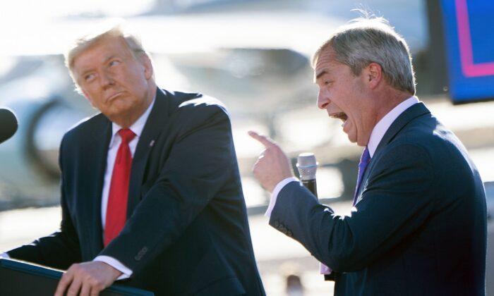 U.S. President Donald Trump listens as Nigel Farage (R) speaks during a Make America Great Again rally at Phoenix Goodyear Airport Oct. 28, 2020, in Goodyear, Arizona. (Brendan Smialowski/AFP via Getty Images)