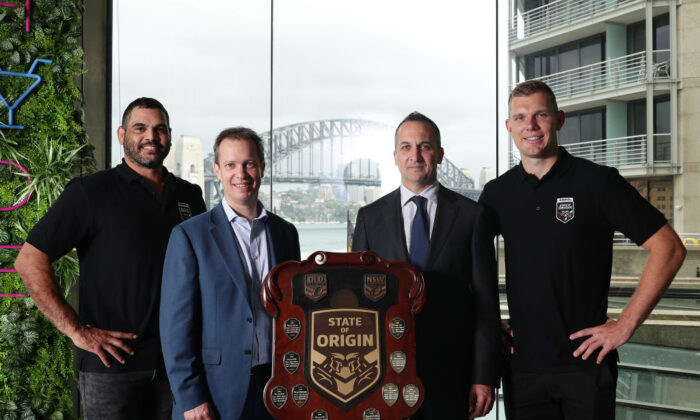 Tom Trbojevic and  Greg Inglis pose with AMPOL CEO Matt Halliday, NRL CEO Andrew Abdo and the state of origin trophy during a State of Origin media opportunity at Pullman Quay Grand Sydney Harbour in Sydney, Australia on Oct. 27, 2020. (Mark Metcalfe/Getty Images)