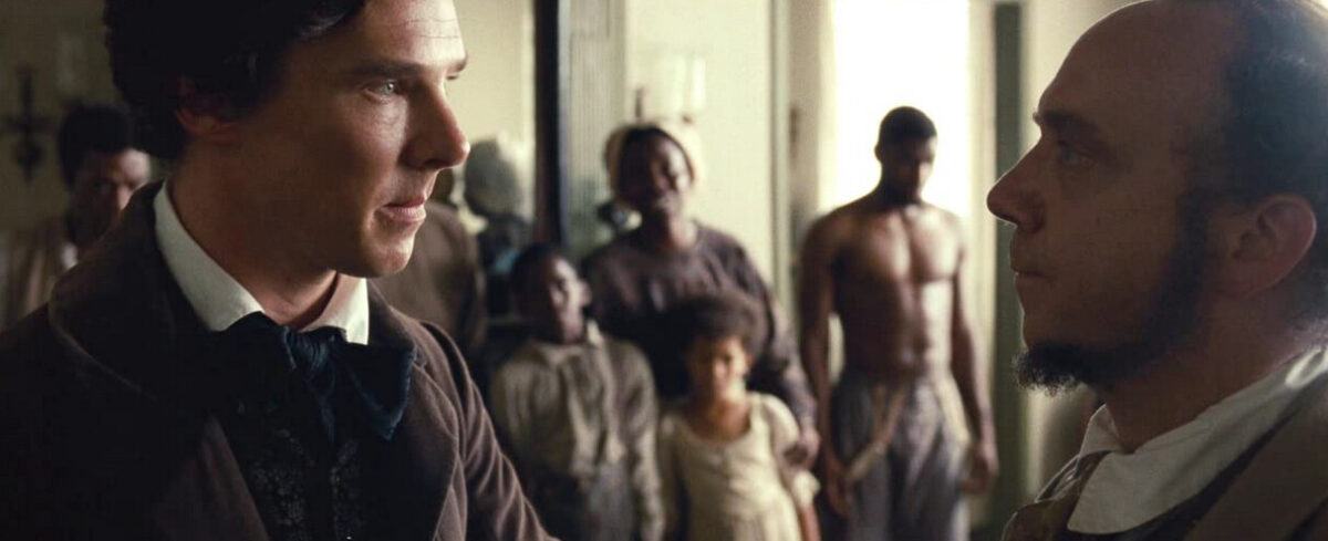 "two men at a slave auction in ""12 Year a Slave"""