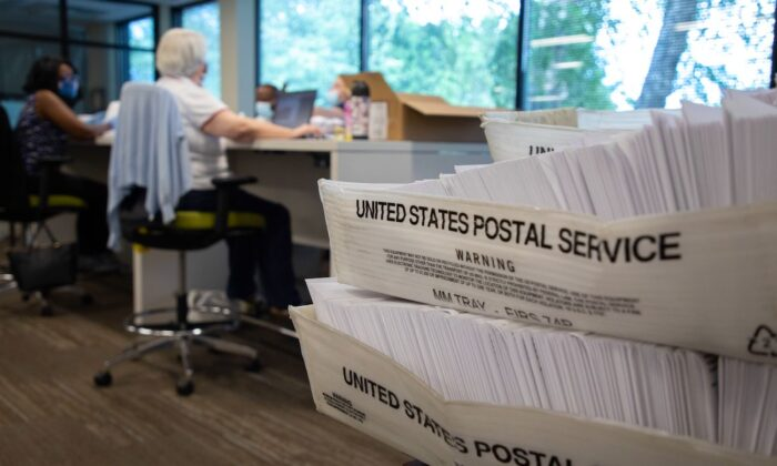 Large boxes of envelopes are seen as absentee ballot election workers stuff ballot applications at the Mecklenburg County Board of Elections office in Charlotte, North Carolina, on Sept. 4, 2020. (Logan Cyrus/AFP via Getty Images)