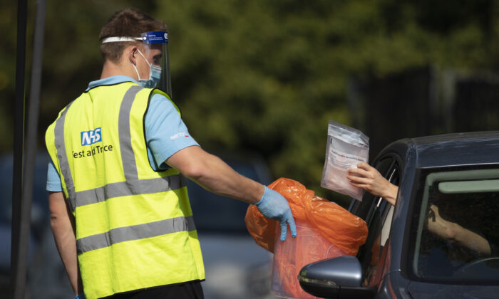 A worker collects a swab test from a member of the public at a COVID Test site in South London on Sept. 15, 2020 ( Dan Kitwood/Getty Images)