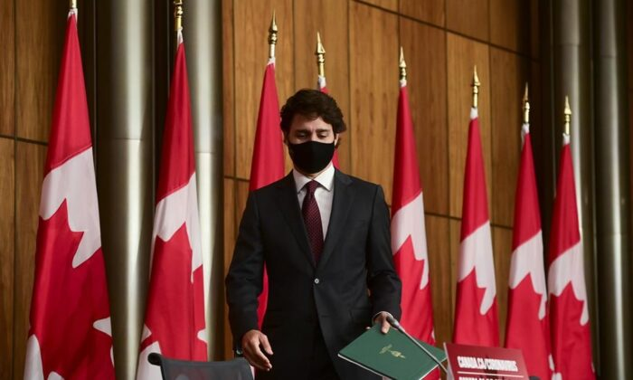 Prime Minister Justin Trudeau arrives to a press conference during the COVID pandemic in Ottawa, on Oct. 13, 2020. (The Canadian Press/Sean Kilpatrick)