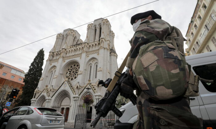 A French soldier stands in front of Notre-Dame church, where a knife attack took place, in Nice, France, on Oct. 29, 2020. (Eric Gaillard/Pool/Reuters)