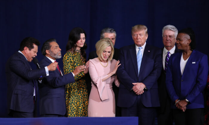 "Faith leaders pray over President Donald Trump during an ""Evangelicals for Trump"" campaign event held at the King Jesus International Ministry in Miami on Jan. 3, 2020. (Joe Raedle/Getty Images)"
