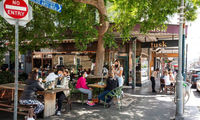 People enjoy outdoor dining at Tusk Cafe in Prahran on October 28, 2020 in Melbourne, Australia. (Daniel Pockett/Getty Images)