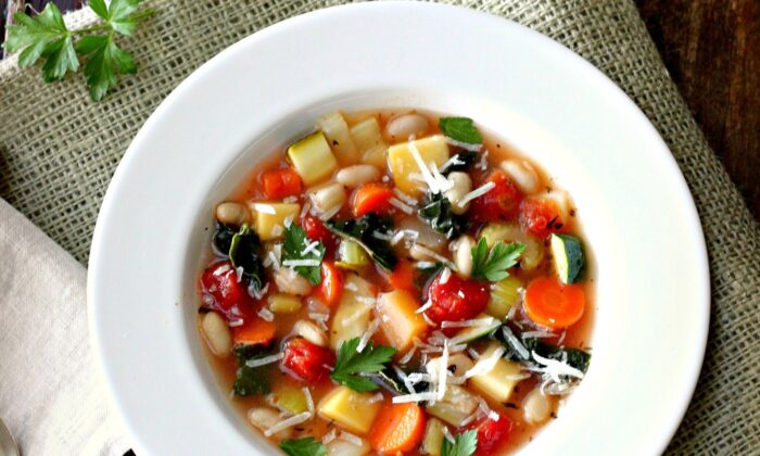 Brimming with diced vegetables swirling in a tomato-infused stock, minestrone is rustic, filling, and layered with flavor. (Lynda Balslev for TasteFood)