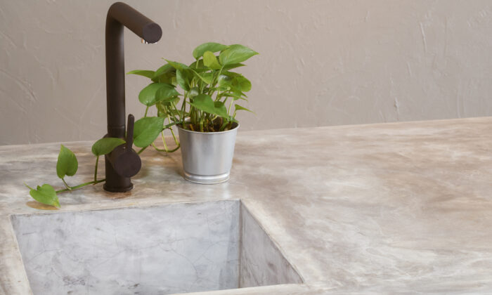 Concrete countertops are attractive, low-maintenance, and reasonably priced. (jamesteohart/Shutterstock)