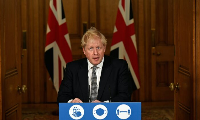 Britain's Prime Minister Boris Johnson gestures as he speaks during a press conference where he announces new restrictions to help combat the CCP virus outbreak, at 10 Downing Street in London, on Oct. 31, 2020. (Alberto Pezzali/Pool via Reuters)