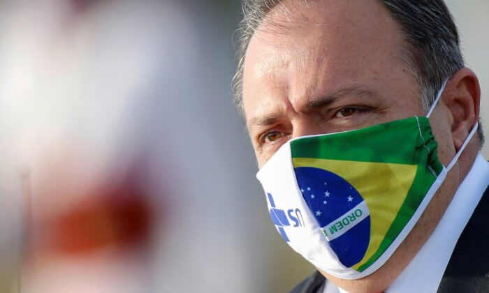 Brazil's interim Health Minister Eduardo Pazuello wears a protective face mask as he looks on before a national flag hoisting ceremony in front the Alvorada Palace, amid the COVID-19 outbreak, in Brasilia, Brazil, on June 9, 2020. (Adriano Machado/Reuters)