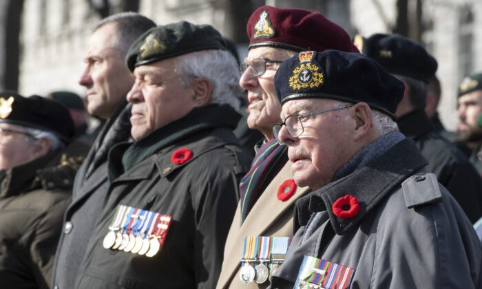 World War II veteran Capt. Albert Morin (R) stands with other veterans during Remembrance Day ceremonies at the Cenotaph in Quebec City on Nov. 11, 2019. Morin, 97, claims to be the last World War II veteran attending the Quebec City celebrations. (The Canadian Press/Jacques Boissinot)