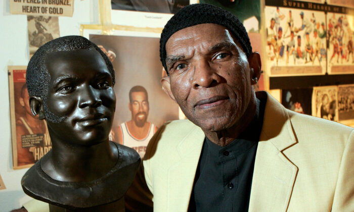Former NFL player Herb Adderley poses next to a copy of his Hall of Fame bust in a room full of memorabilia from his playing days at his home in Mantua, N.J., on Oct. 2, 2008. (Mel Evans/AP Photo, File)