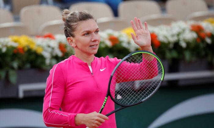 Tennis—French Open—Romania's Simona Halep celebrates winning her second round match against Romania's Irina-Camelia Begu, Roland Garros, Paris, France, Sept. 30, 2020. (Charles Platiau/Reuters)