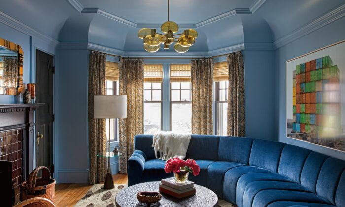 The family room is the most-used room in the house. With mid-blue walls and a sapphire velvet sectional, the room radiates warmth and coziness. (Paul Raeside)
