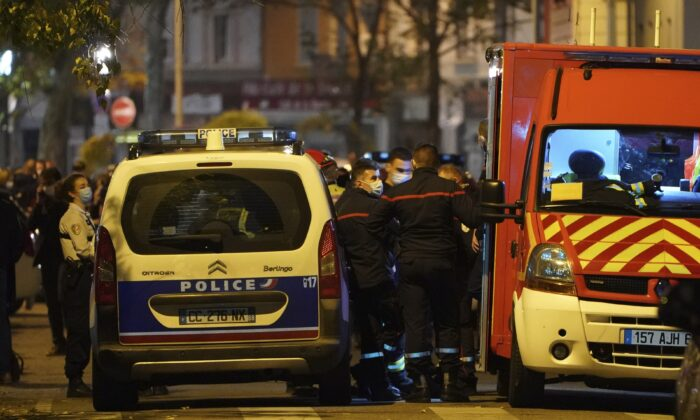 Police officers and rescue workers block the access to the scene after a Greek Orthodox priest was shot, on Oct. 31, 2020 while he was closing his church in the city of Lyon, central France. (Laurent Cipriani/AP Photo)