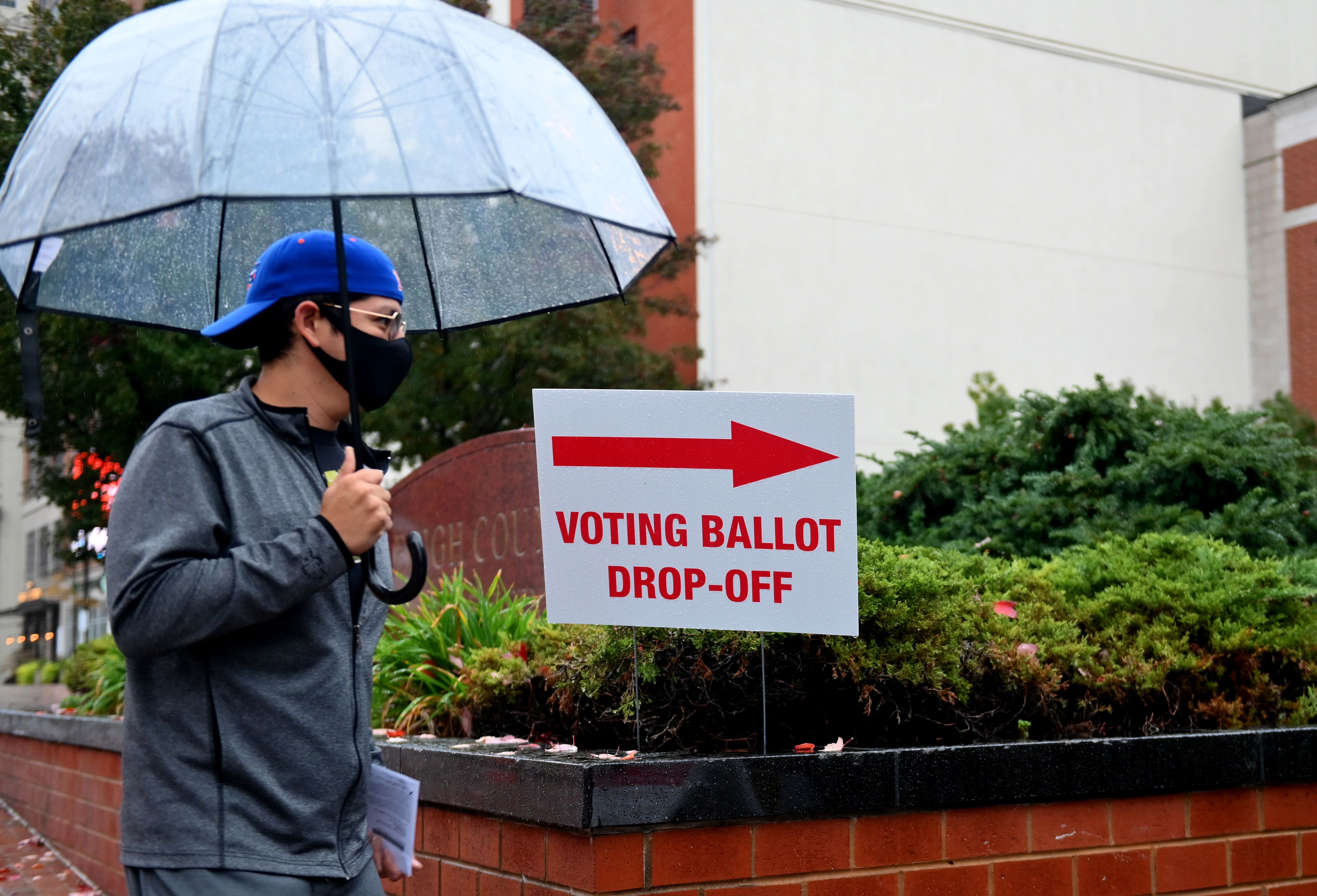 A voter arrives to drop off his ballot