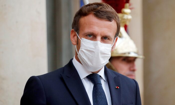 French President Emmanuel Macron, wearing a face mask, at the Elysee Palace in Paris, on October 22, 2020. (Charles Platiau/Pool/AFP via Getty Images)