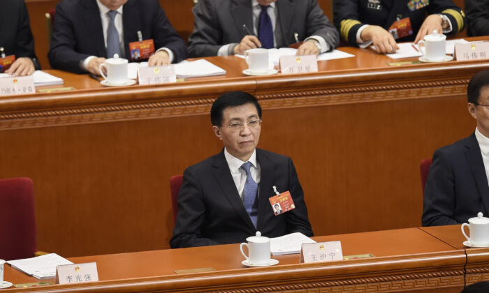 Wang Huning attends the opening session of CCP's rubber stamp legislative conference at the Great Hall of the People in Beijing on Mar. 5, 2019. (Wang Zhao/AFP via Getty Images)