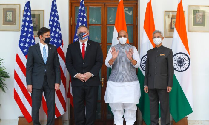 U.S. Secretary of State Mike Pompeo (2nd L), U.S. Secretary of Defense Mark Esper (L), India's Defense Minister Rajnath Singh (2nd R) and India's Foreign Minister Subrahmanyam Jaishankar pose for pictures before their meeting at Hyderabad House in New Delhi on Oct. 27, 2020. (Adnan Abidi/POOL/AFP via Getty Images)