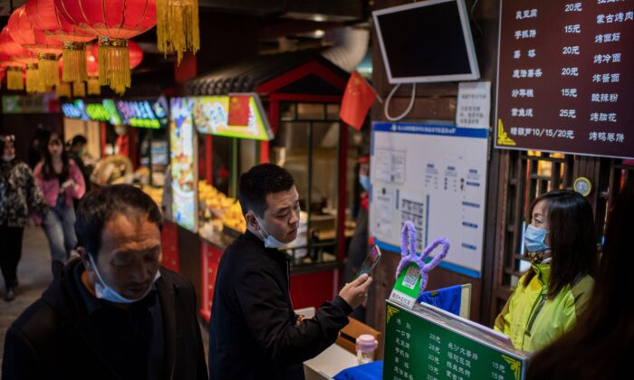 A customer (C) scanning a QR payment code to pay at a restaurant in Beijing on Oct. 28, 2020. (Nicolas Asfouri/AFP via Getty Images)