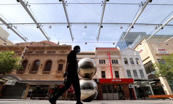 A women walks past the silver balls in Rundle Mall on November 20, 2020 in Adelaide, Australia. (Kelly Barnes/Getty Images)