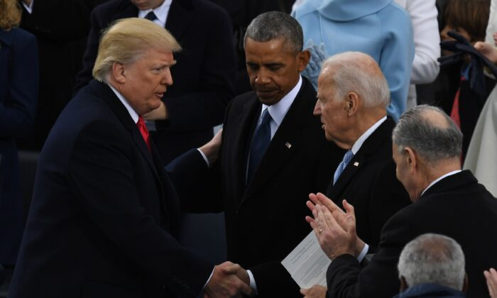 President Donald Trump (L) shakes hands with former President Barack Obama (C) and former Vice President Joe Biden after being sworn in as President at the Capitol in Washington on Jan. 20, 2017. (Mark Ralston/AFP via Getty Images)