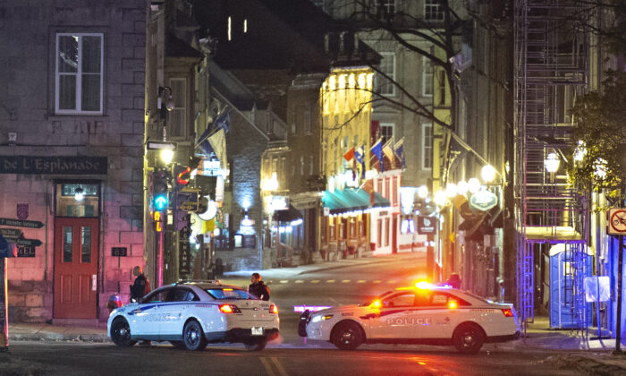 Police cars block the Saint-Louis Street near the Chateau Frontenac in Quebec City, Canada, early on Nov. 1, 2020. (Jacques Boissinot/The Canadian Press via AP)