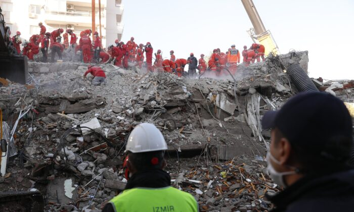 Members of rescue services search in the debris of a collapsed building for survivors in Izmir, Turkey, on Nov. 1, 2020. (Darko Bandic/AP Photo)