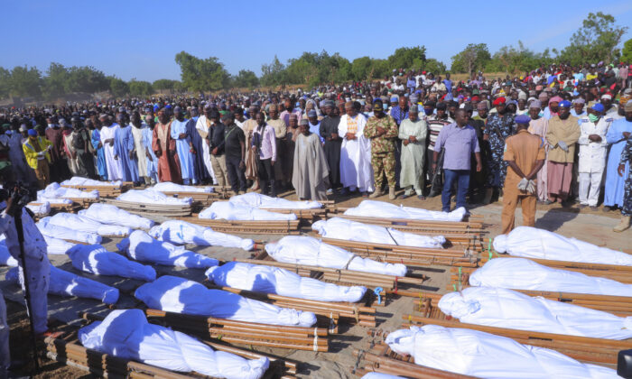 People attend a funeral for those killed by suspected Boko Haram militants in Zaabarmar, Nigeria on Nov. 29, 2020. (Jossy Ola/AP Photo)