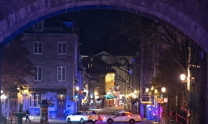 Police cars block the Saint-Louis Street near the Chateau Frontenac, on Nov. 1, 2020 in Quebec City. A man wearing medieval clothed was arrested. Two people are dead and five people were injured after they were stabbed. (The Canadian Press/Jacques Boissinot)