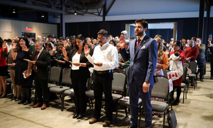 New Canadians take the Oath of Citizenship in a ceremony at the Canadian Museum of Immigration at Pier 21 in Halifax on Jan. 15, 2020. (The Canadian Press/Riley Smith)