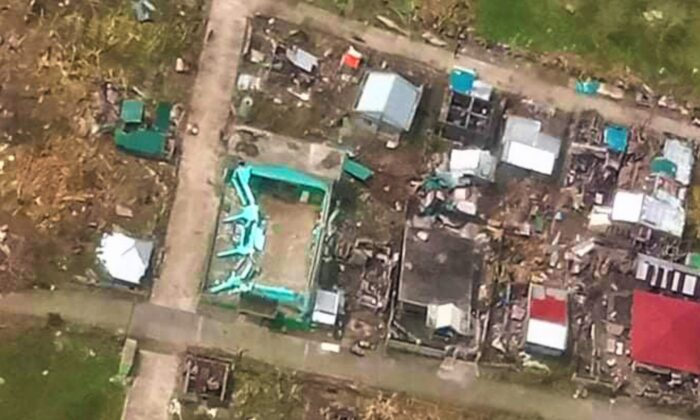 In this photo provided by the Philippine Coast Guard, damaged homes are seen at Catanduanes province, eastern Philippines in this aerial photo on Nov. 2, 2020. (Philippine Coast Guard via AP)