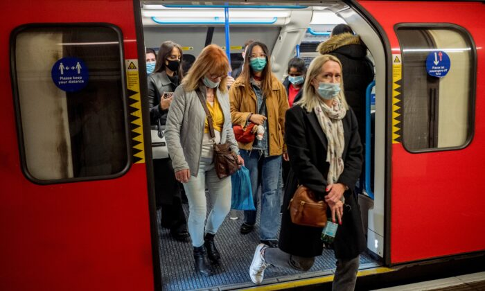Commuters wear face-masks during morning rush hour on the Victoria Line of the London Underground in central London on Oct. 16, 2020. (Tolga Akmen/AFP via Getty Images)