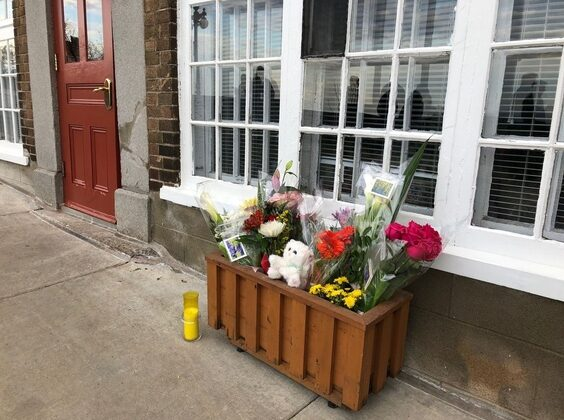 Flowers and a candle are placed in front of the house of a woman who died in the Halloween attack on Oct. 31, 2020, in Quebec City. (Anne-Sophie Thill/AFP via Getty Images)