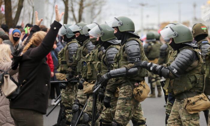 Belarusian law enforcement officers block opposition supporters during their rally to reject the presidential election results in Minsk, Belarus Nov.1, 2020. (Stringer/Reuters)