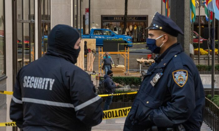A police officer and a security guard are seen in New York City on Nov. 2, 2020. (David Dee Delgado/Getty Images)