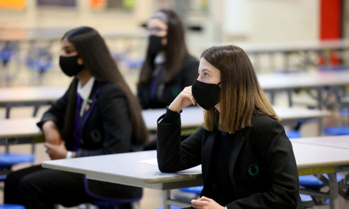 Pupils at Rosshall Academy wear face coverings in Glasgow, Scotland, on Aug. 31, 2020. Face coverings later became mandatory in high-risk schools in Scotland. (Jeff J Mitchell/Getty Images)